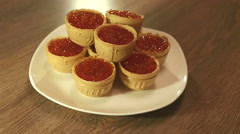 Tartlet with cheese and salmon caviar rotating 360 Stock Footage