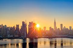 Midtown Manhattan skyline at sunrise Stock Photos
