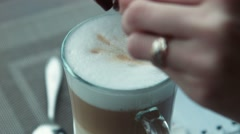 The girl fills sugar in coffee and stirs Stock Footage