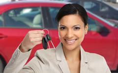 Car dealer woman with key. - stock photo