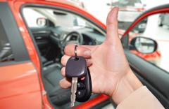 Driver hand with a car key. - stock photo