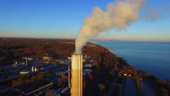 Aerial 4K UHD - Bird's eye view of wastewater plant with chimney Stock Footage
