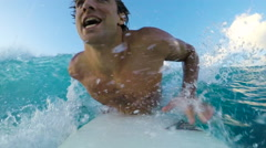 Surfer on Blue Ocean Wave Surfing Down The Line. GOPRO POV SELFIE - stock footage