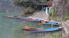 Colorful tourist boats at Phewa Lake Stock Footage