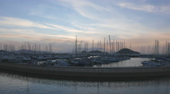 A calm view of marina with moored yachts after sunset. 4k Stock Footage