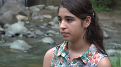 Solemn Teenage Girl at River Stock Footage