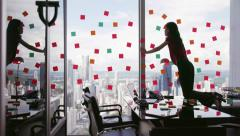 1 Business Person Attaching Sticky Notes On Large Window - stock footage