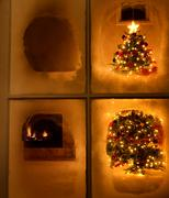 Christmas night time view of tree through frosted window still Stock Photos