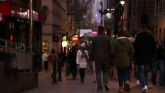 People walk down street in London at night Stock Footage