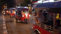 Thai Tuk Tuk Taxi with Tourists in Thailand Stock Footage