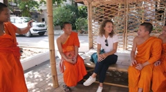 Tourist Girl Talking with Buddhist Monks. Traveling and Religion - stock footage