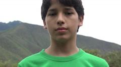 Teen Boy Posing with Mountain Stock Footage