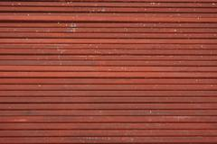 line up tube of iron coat in red corrosion resistant - stock photo
