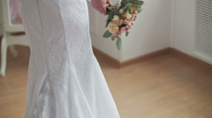 Beautiful bride with the bouquet near the mirror Stock Footage