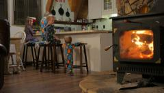 Kids climbing up on stools in the kitchen for a snack Stock Footage