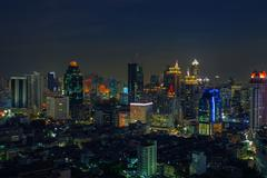 Stock Photo of city scape in heart of bangkok thailand with beautiful lighting of office bui