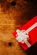 Wrapped gift box on woden table Stock Photos