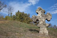 Old orthodox cross near the Cathedral of the Transfiguration of the Saviour - stock photo