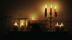 Old vintage books with candles in candlestick. - stock footage