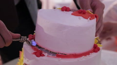 Cutting and folding plates on  the wedding cake Stock Footage