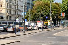 Busy Traffic And People On Downtown Streets Of Vienna City In Summer - stock photo