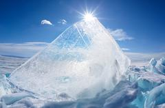 Ice floe and sun on winter Baikal lake Stock Photos