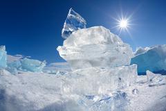 Ice floe crystal and sun over Baikal lake - stock photo