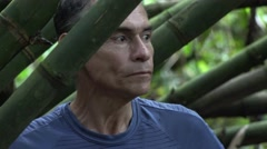 Fearful Man Lost in Jungle Stock Footage