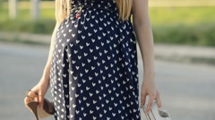 Pregnant woman chooses shoes for walking Stock Footage