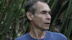 Confused Man Alone in Jungle Stock Footage