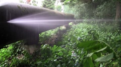 Powerful jet of water flowing from a broken metal duct Stock Footage