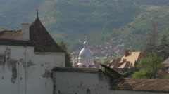 The dome of Saint Parascheva Church seen from the fortifications walls of Brasov Stock Footage