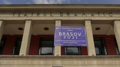 Purple banner hanging between the columns of Sica Alexandrescu Theatre in Brasov Stock Footage