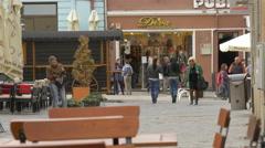 Walking on Diaconu Coresi street, near Publik Cafe, Brasov Stock Footage