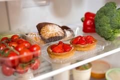 Choice of food in the fridge at home - stock photo