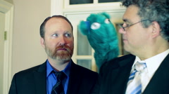 Puppet talking to businessmen business men Stock Footage