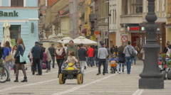 Kids driving pedal karts and electric jeeps in Council Square, Brasov Stock Footage