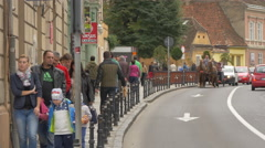Two horses pulling a carriage on Muresenilor street in Brasov Stock Footage