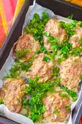 Baked meat balls with the greens - stock photo
