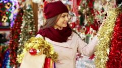 Portrait of female customer choosing eucalyptus decorations Stock Footage