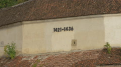 Years on an old building's wall in Brasov Stock Footage