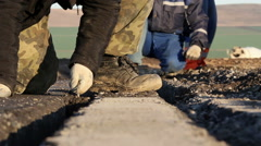 Stock Video Footage of Workers dig trenches to lay cables for the airfield lighting system