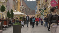 Walking on Republic street, a pedestrian-only street in Brasov - stock footage