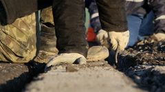Workers dig trenches to lay cables for the airfield lighting system - stock footage