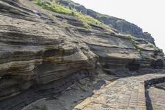 Sedimentary rock at Yongmeori coast in Jeju island Stock Photos