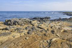 Coast of Jeju island with Volcanic rocks - stock photo