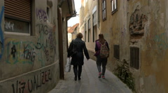 Walking on a narrow alley in Brasov Stock Footage