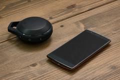 Smartphone and Wireless speaker - stock photo