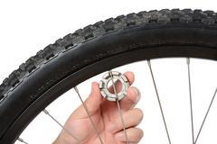 bike wheel truing and maintenance - stock photo