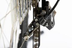 closeup of rear deraileur adjusting screws - stock photo